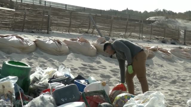 marines and sailors from mcas iwakuni clean up tsunoshima island, japan of debris and litter. marine wildlife is under threat from the waste and... - ポリスチレン点の映像素材/bロール