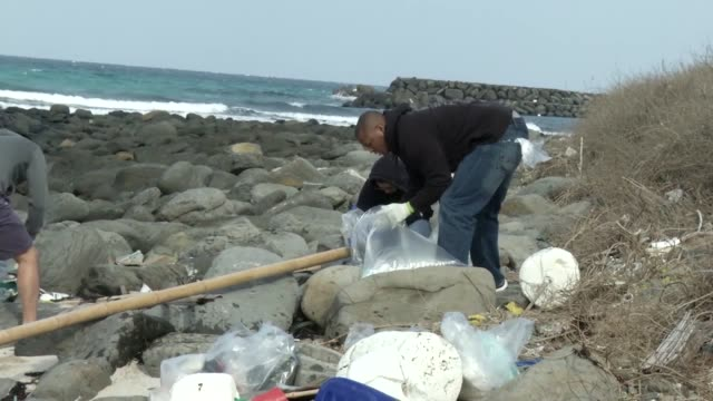 marines and sailors from mcas iwakuni clean up tsunoshima island japan of debris and litter marine wildlife is under threat from the waste and litter... - polystyrene stock videos & royalty-free footage