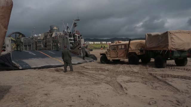 marines and soldiers with japan ground self defense force conduct an amphibious landing exercise at marine corps base camp pendleton, california,... - ホバークラフト点の映像素材/bロール