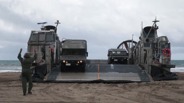 us marines and soldiers with japan ground self defense force conduct an amphibious landing exercise at marine corps base camp pendleton california... - japan ground self defense force stock videos and b-roll footage