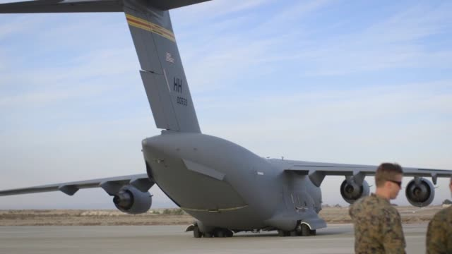 us marines and us airmen unload a uh1y venom from a c17 globemaster iii in support of weapons and tactics instructor course 218 at mcas yuma ariz... - us airforce stock videos & royalty-free footage