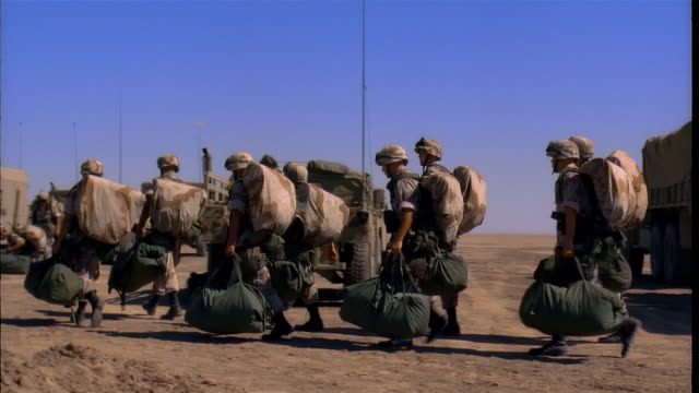 ms, pan, reenactment us marines arriving to camp, kuwait - us marine corps stock videos & royalty-free footage