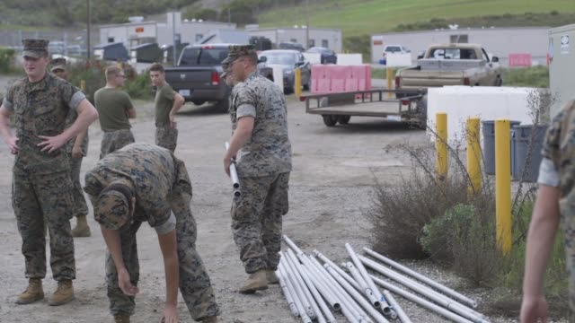us marines assemble tents at a medical isolation and observation center being set up near the 13 area on marine corps base camp pendleton california... - marines military stock videos & royalty-free footage