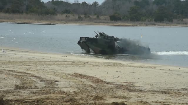 marines assigned to 4th marine division, 1st platoon, perform an attack-the-beach maneuver in an amphibious assault vehicle during a training... - amphibious vehicle stock videos & royalty-free footage