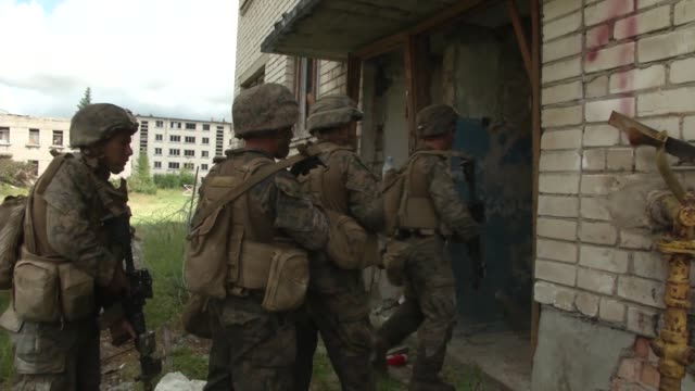US Marines assigned to Company C 1st Battalion 6th Marine Regiment participate in a modern operations urban terrain training exercise alongside...