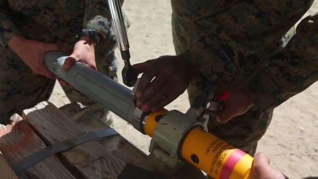 marines assigned to marine aviation weapons and tactics squadron 1 use a torque wrench to assemble a 2.75-inch rocket configured with advanced... - wrench stock videos & royalty-free footage