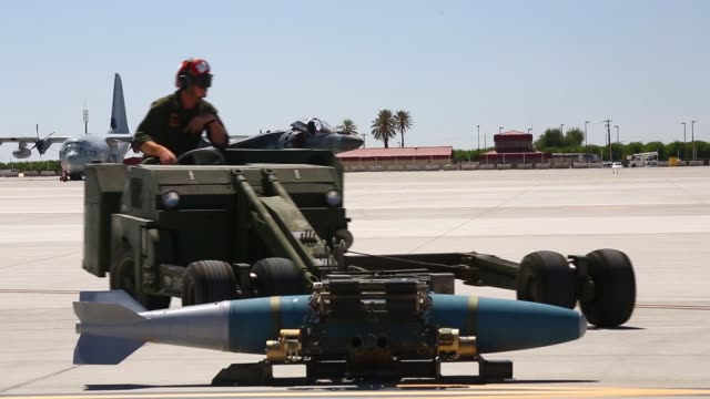 us marines assigned to marine aviation weapons and tactics squadron one conduct an ordnance load drill on an av8b harrier ii during weapons and... - drill instructor stock videos & royalty-free footage