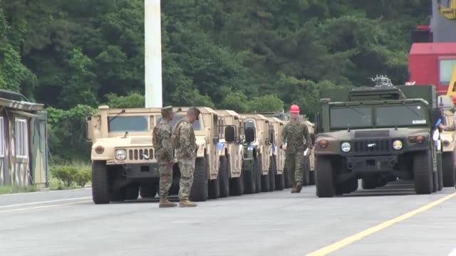 us marines assigned with task force 2/24 iii marine expeditionary force offload equipment from usns 2nd lt john p bobo docked in chinhae south korea... - military exercise stock videos & royalty-free footage