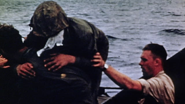 marines assisting wounded man from higgins boat and aboard lcm / iwo jima japan - battle of iwo jima stock videos and b-roll footage