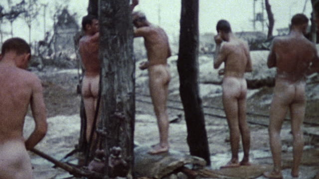 Marines bathing under outdoor makeshift showers during WWII