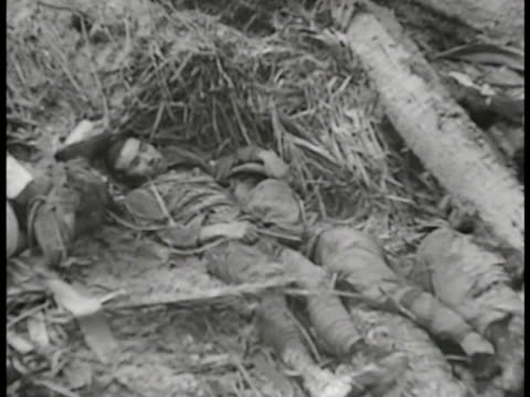 marines checking inside sandbag bunker graphic dead japanese soldiers in sand ms medic caring for wounded japanese soldier ms medic working on neck... - stillahavskriget bildbanksvideor och videomaterial från bakom kulisserna