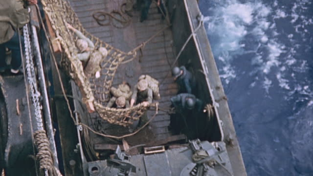 marines climbing down rope net from uss hansford to landing craft marines waiting to disembark lcm underway during world war ii pacific campaign - battle of iwo jima stock videos and b-roll footage