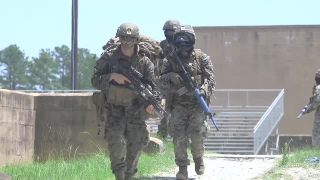 us marines compete in 2019 super squad competition at camp lejeune north carolina where they are evaluated on marksmanship skills physical fitness... - audio electronics stock videos and b-roll footage
