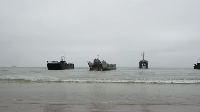 Marines conduct an amphibious landing to secure a beach in Lithuania as part of BALTOPS 2019 a multinational amphibious exercise held in the Baltic...