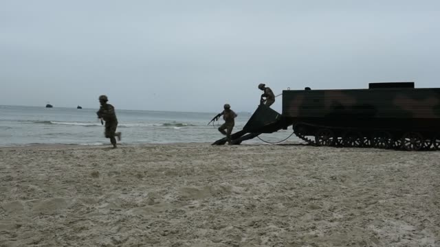 marines conduct an amphibious landing to secure a beach in lithuania as part of baltops 2019 a multinational amphibious exercise held in the baltic... - amphibious vehicle stock videos & royalty-free footage
