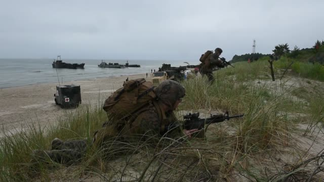 marines conduct an amphibious landing to secure a beach in lithuania as part of baltops 2019 a multinational amphibious exercise held in the baltic... - lithuania stock videos and b-roll footage