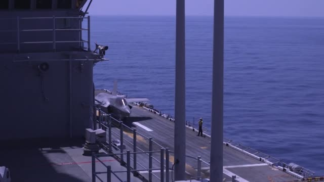 us marines conduct flight operations with f35b ii lightnings aboard amphibious assault ship uss wasp in international airspace over the philippine... - philippine sea stock videos & royalty-free footage