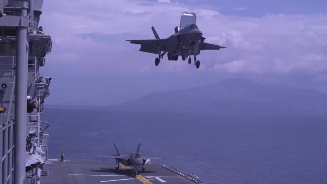 us marines conduct flight operations with f35b ii lightnings and mv22 ospreys aboard amphibious assault ship uss wasp in international airspace over... - b rolle stock-videos und b-roll-filmmaterial