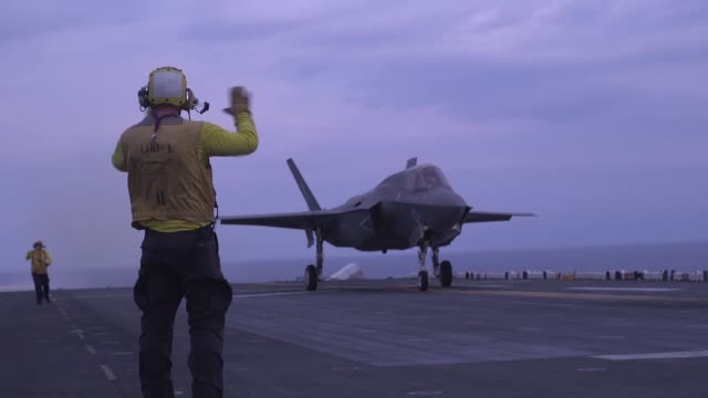 marines conduct flight operations with f-35b ii lightnings and mv-22 ospreys aboard amphibious assault ship uss wasp in international airspace over... - us marine corps stock videos & royalty-free footage