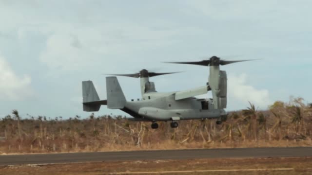 marines conducting forward arming and refueling point operations nov. 21 at guiuan airfield, republic of the philippines, during operation damayan.... - us marine corps stock videos & royalty-free footage