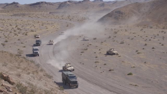 marines convoy on a main supply route during a motorized operators course as part of integrated training exercise 5-19 at marine corps air ground... - main course stock videos & royalty-free footage