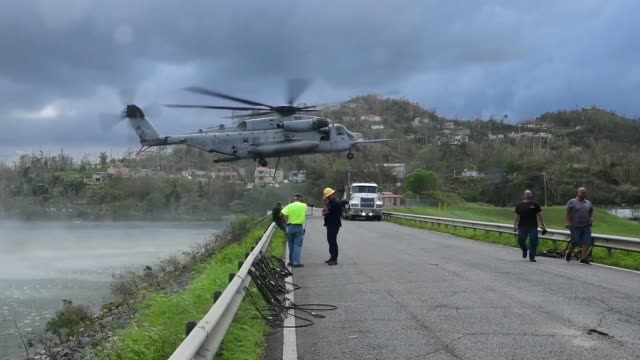 a us marines corps ch53 sikorsky sea stallion heavylift transport helicopter lifts fiveton jersey barriers into the guajataca dam in guajataca... - 米国海兵隊点の映像素材/bロール