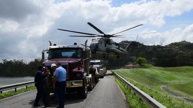 marines corps ch53, sikorsky sea stallion heavy-lift transport helicopter, lifts five-ton jersey barriers into the guajataca dam, in guajataca,... - emergency planning stock videos & royalty-free footage