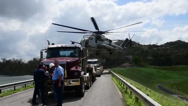 a us marines corps ch53 sikorsky sea stallion heavylift transport helicopter lifts fiveton jersey barriers into the guajataca dam in guajataca... - emergency equipment stock videos & royalty-free footage
