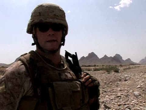 us marines driving along the bhuji bhast pass in remote southwest afghanistan dodge improvised explosive devices at every turn in what is effectively... - us marine corps stock videos & royalty-free footage