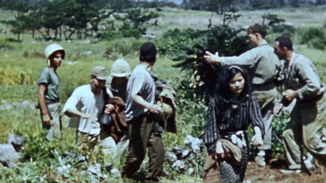 marines escorting local civilians and japanese prisoners, and the shoreline / okinawa, japan - civilian stock videos & royalty-free footage