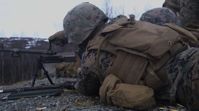 marines fire m240b machine guns and benelli m4 shotguns during deployment for training at bardufoss firing range, norway, may 27, 2019. - gun barrel stock videos & royalty-free footage