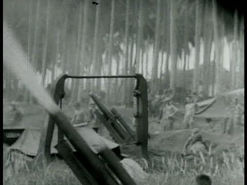 marines firing artillery in clearing. aerial: grumman f4f 'wildcats' in flight. f4fs over water. diving firing on unidentified small boat. southern... - world war ii点の映像素材/bロール
