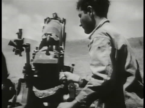 marines firing artillery us tank firing cu us marines firing artillery soldier discarding shell ha shells exploding in open field wwii pacific theater - saipan stock videos and b-roll footage