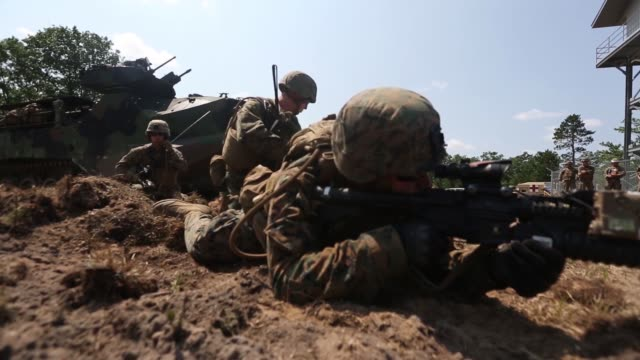 marines from india company, 3rd battalion, 25th marine regiment, conduct a live-fire range with amphibious assault vehicle support during exercise... - amphibious vehicle stock videos & royalty-free footage