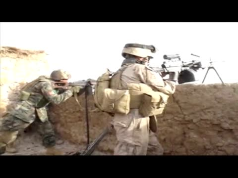 us marines from the 1/3 marines weapons company and afghan soldiers battled monday with taliban fighters who had ambushed them a day earlier on the... - graphic war footage stock videos & royalty-free footage