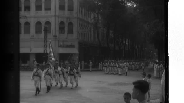 marines from the light cruiser natori disembark and march through saigon where commanding officer hara and his staff place wreathes at the monument... - indocina video stock e b–roll
