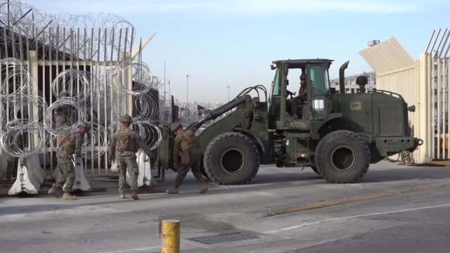 vídeos de stock e filmes b-roll de marines from the us marine corps special purpose marine air ground task force seven prepare equipment and barriers in preparation for the closure of... - veículo terrestre comercial