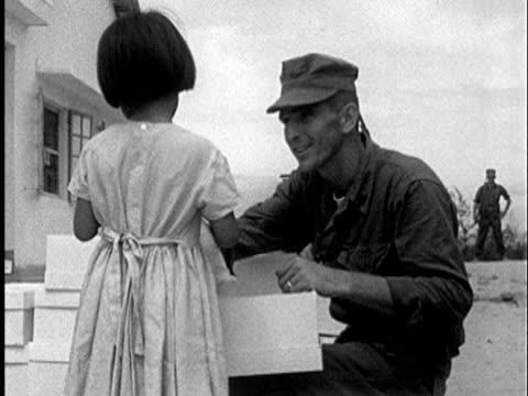 vídeos y material grabado en eventos de stock de s marines handing out toy dolls to vietnamese girls ms smiling little girl holding box with doll / vietnam / audio - prelinger archive