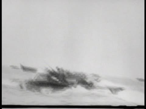 vídeos de stock e filmes b-roll de ws us marines in amphibious tractors on water vs us aircraft firing on japanese positions on island shoreline explosions world war ii wwii - veículo anfíbio