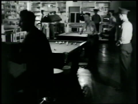 marines in bar playing pool drinking reprisal vs men playing cards at table 'what am i going to do if a jap pokes me in the nose' 'you can duck can't... - united states marine corps stock-videos und b-roll-filmmaterial