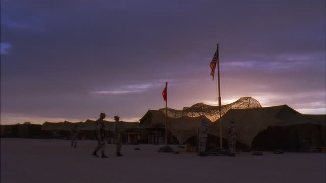 ms, reenactment us marines in camp at dusk, kuwait - saluting stock videos & royalty-free footage