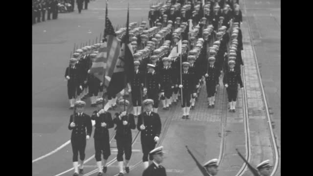marines in combat gear march in parade before crowds in foreground and background / ls parade of us navy waves march toward camera beneath banner... - major league soccer stock videos and b-roll footage