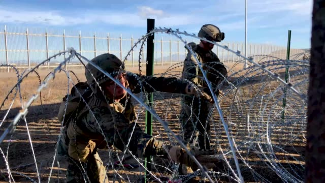 US Marines install razor wire next to the USMexico border fence on December 2 2018 as seen from Tijuana Mexico Marines continued reinforcing the...