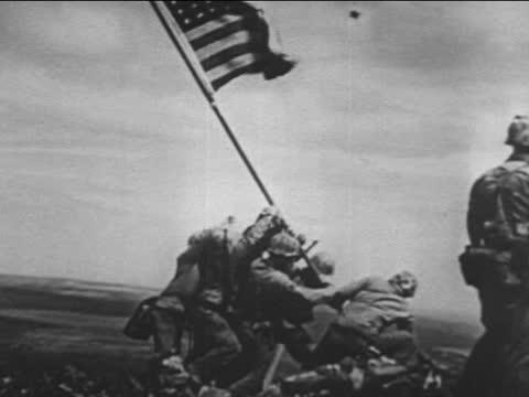 marines landing at iwo jima/ rising of us flag - battle of iwo jima stock videos & royalty-free footage