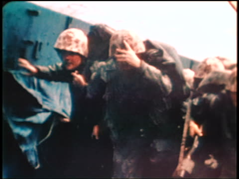 marines landing on beach of iwo jima island / documentary - iwo jima island stock videos & royalty-free footage