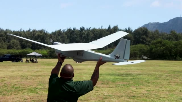 us marines launch drones from marine corps base hawaii - 無人航空機点の映像素材/bロール