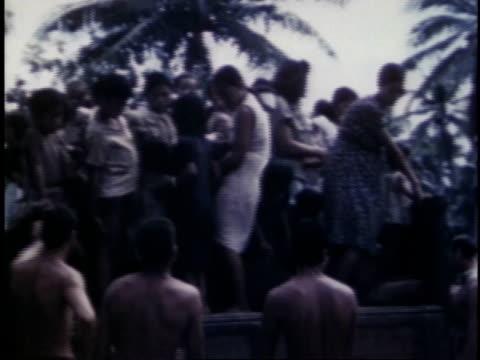 marines lifting village children onto truck transporting villagers / guam - guam stock videos & royalty-free footage