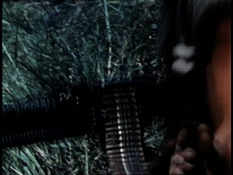marines loading and firing heavy machine gun in combat situation / south vietnam - south vietnam stock videos and b-roll footage