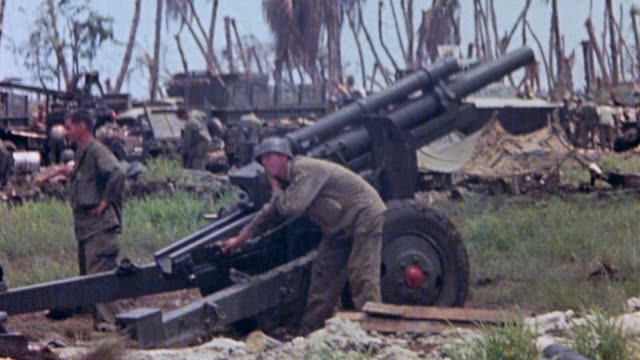 marines loading and firing m101 105mm howitzer / guam mariana islands - mariana islands stock videos and b-roll footage