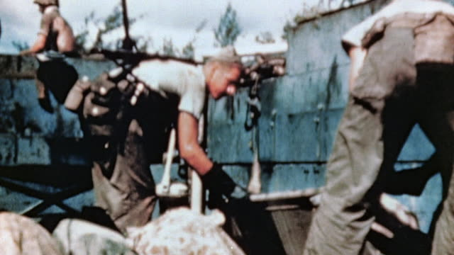 ws marines loading casualties in body bags onto lvt / saipan mariana islands - saipan stock videos and b-roll footage